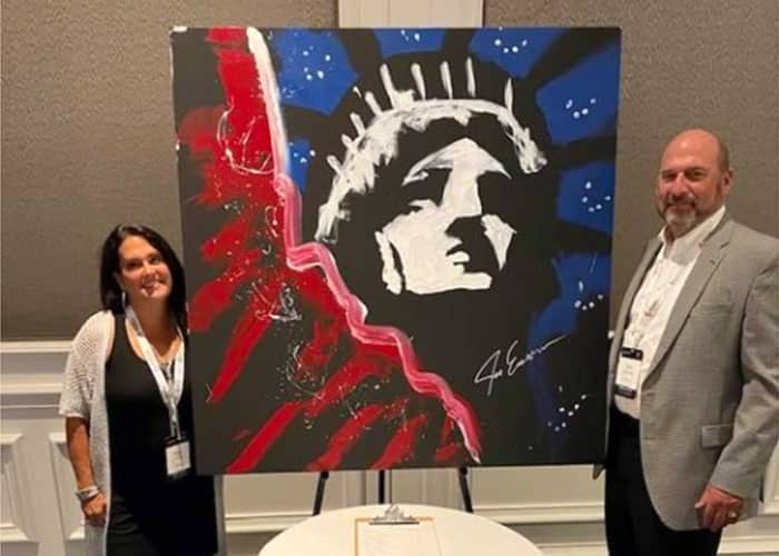 An image featuring the Statue of Liberty painting auctioned off during the 2021 PDA meeting.